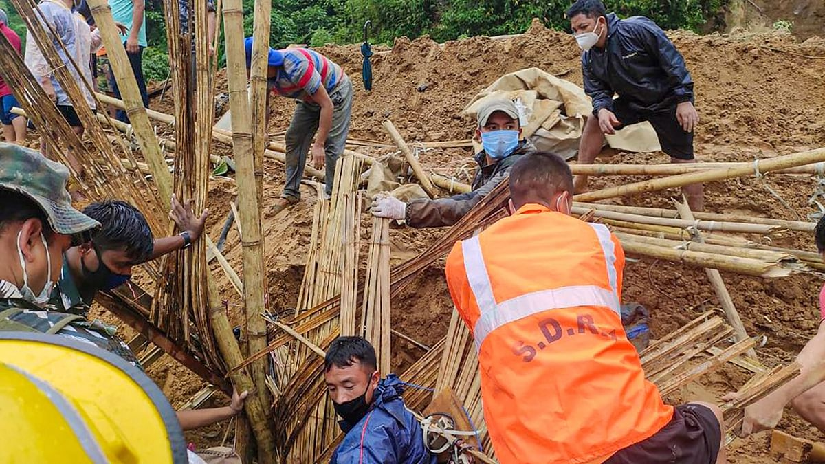 Rescue operation being carried out after a massive landslide hit a house following incessant rainfall, in Itanagar.