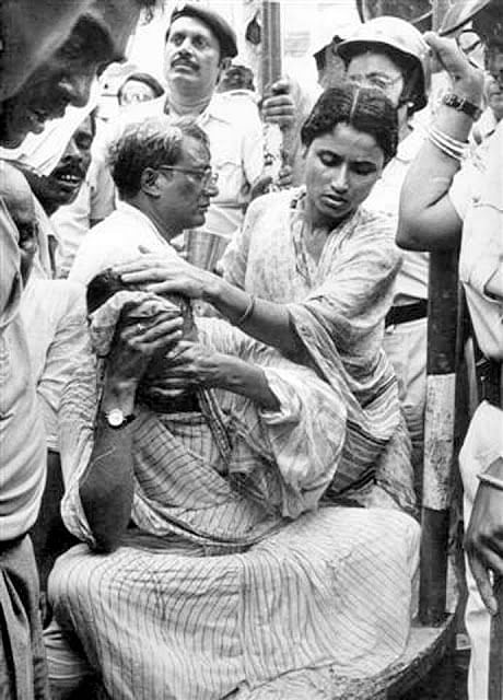 An injured Mamata Banerjee on 21 July 1993 as fellow protestors try to help her.
