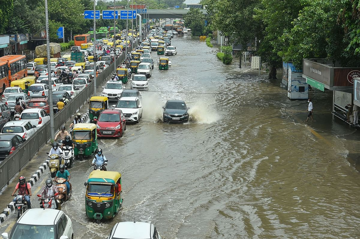 Traffic on a flooded road at ITO following rains in New Delhi.