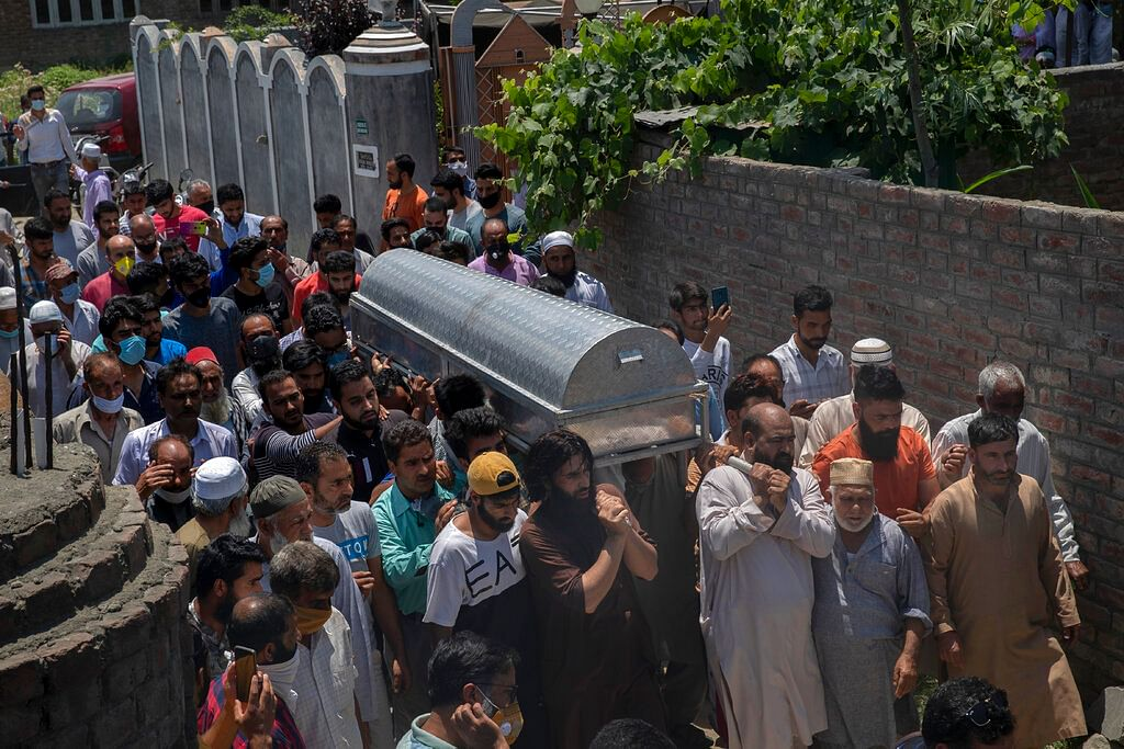 Relatives and neighbours carry the coffin of civilian Bashir Ahmed Khan during his funeral on the outskirts of Srinagar, Wednesday, July 1, 2020.