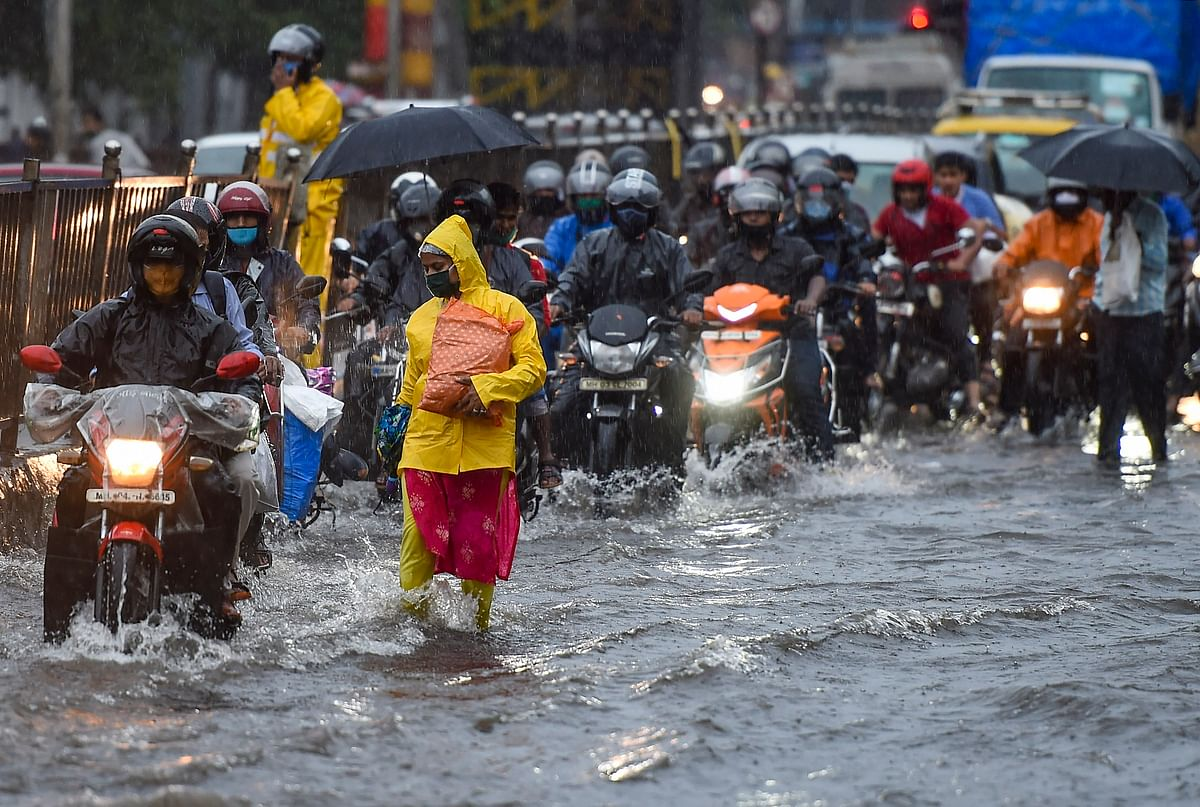 Vehicular traffic tries to move ahead in a water-logged street in Sion.
