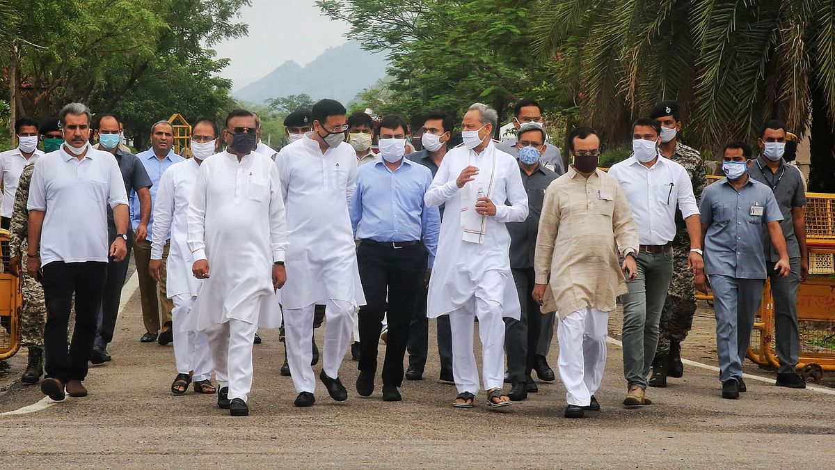 File image: Rajasthan CM Ashok Gehlot along with senior Congress leaders arrive to address media outside a hotel in Jaipur on 24 July.