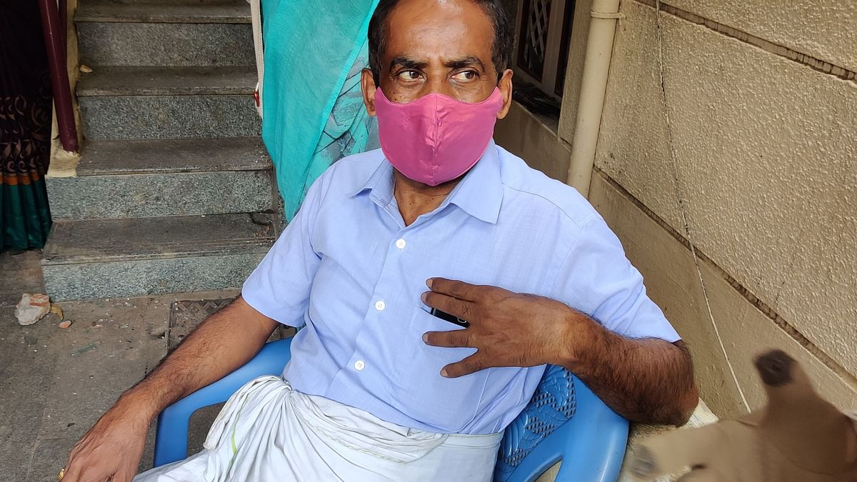 Pavan Kumar outside his house. A derogatory post by his son Naveen had led to the violence in DJ Halli.