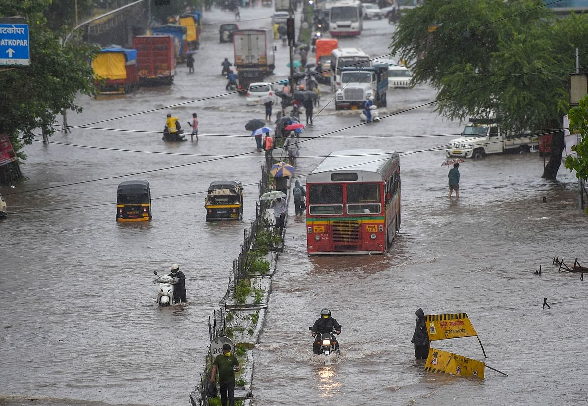 Vehicles ply on a waterlogged street in Kurla.
