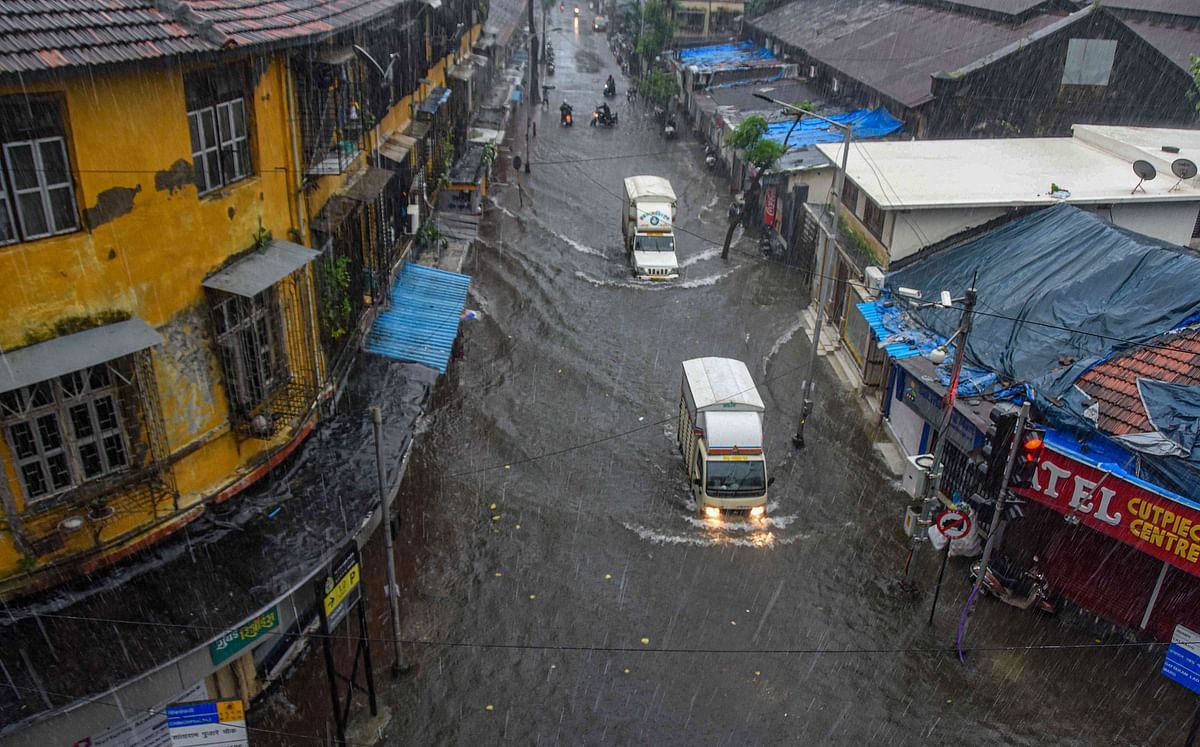 Vehicles ply on a waterlogged street in Byculla.
