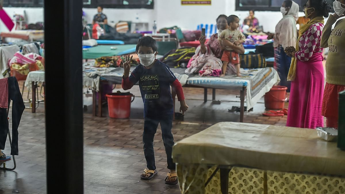 COVID-19 infected child dances inside a ward at the Commonwealth Games (CWG) Village sports complex, temporarily converted into a Covid care centre, in New Delhi, Thursday, 27 August, 2020.
