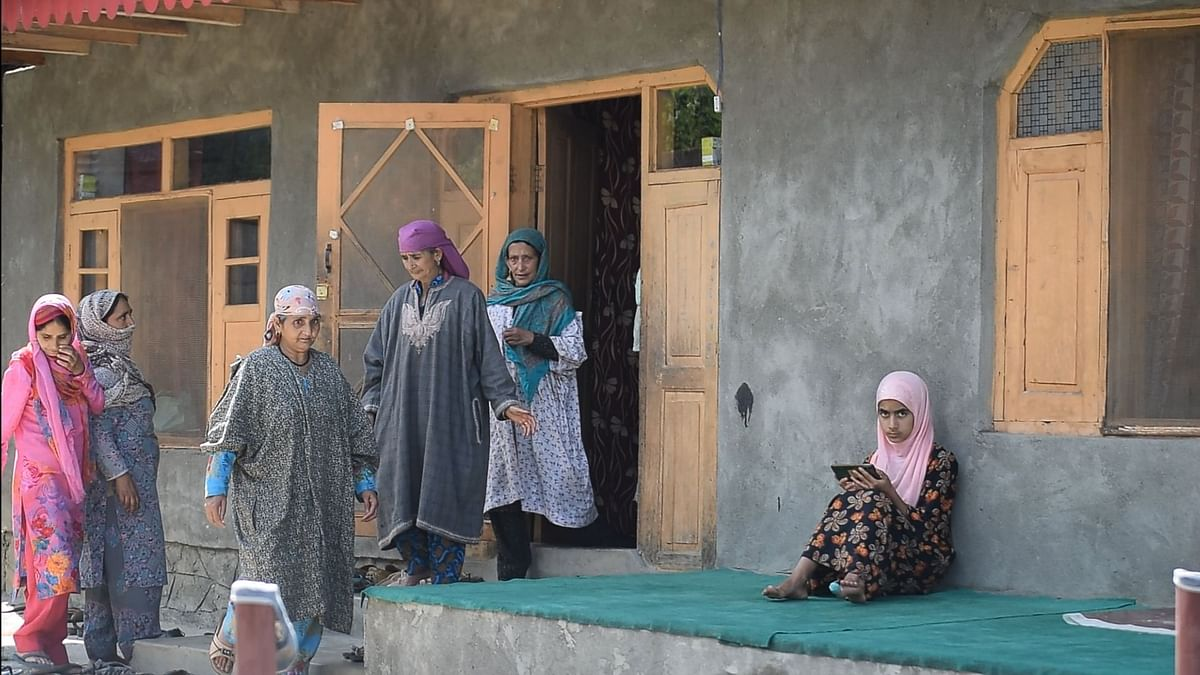 Women from the neighbourhood visiting the home of Shah to share their sympathies and blessings with his family.