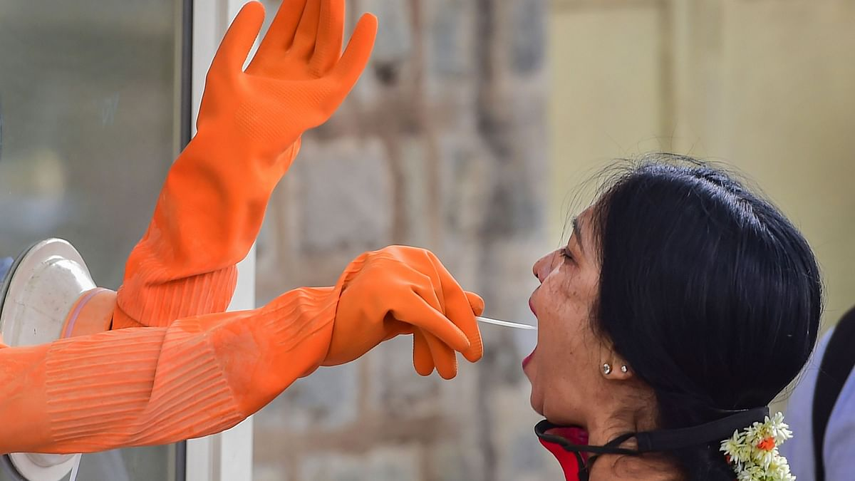 File Image: A medic collects swab sample of a woman for the Covid-19 test at a free coronavirus testing centre, in Bengaluru, Wednesday, 19 August, 2020.