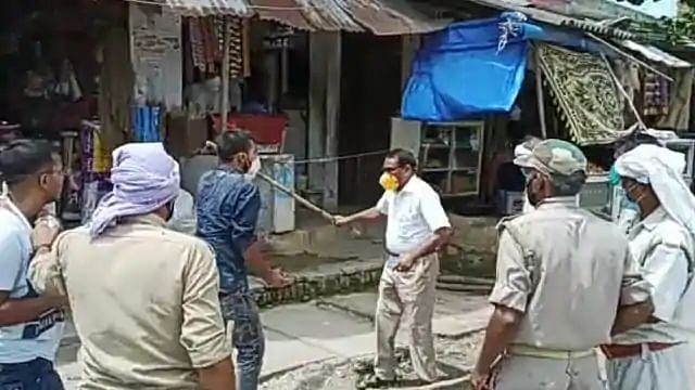 Uttar Pradesh's Balia district's SDM was seen going hitting people with a stick during a mask checking drive.