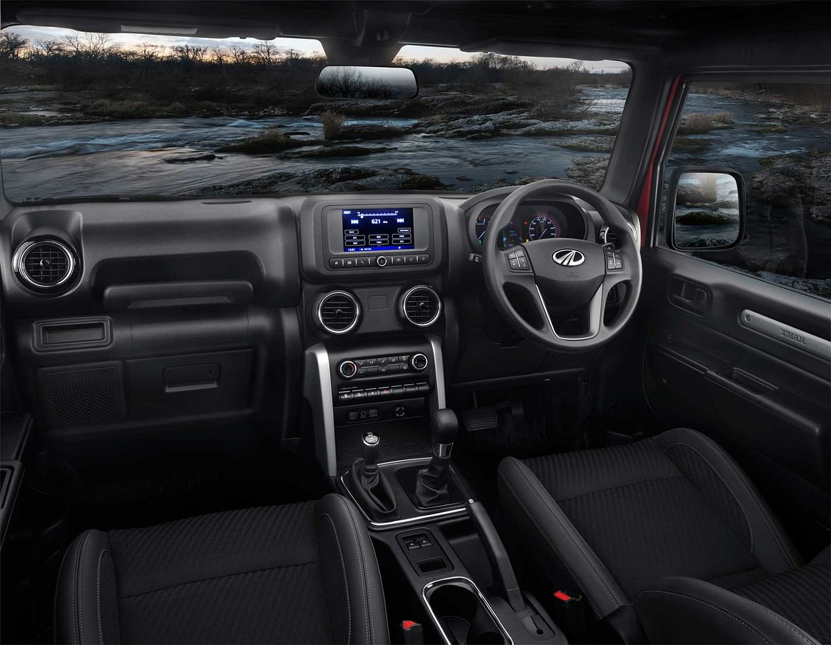 The dashboard adds a 7-inch infotainment touchscreen.