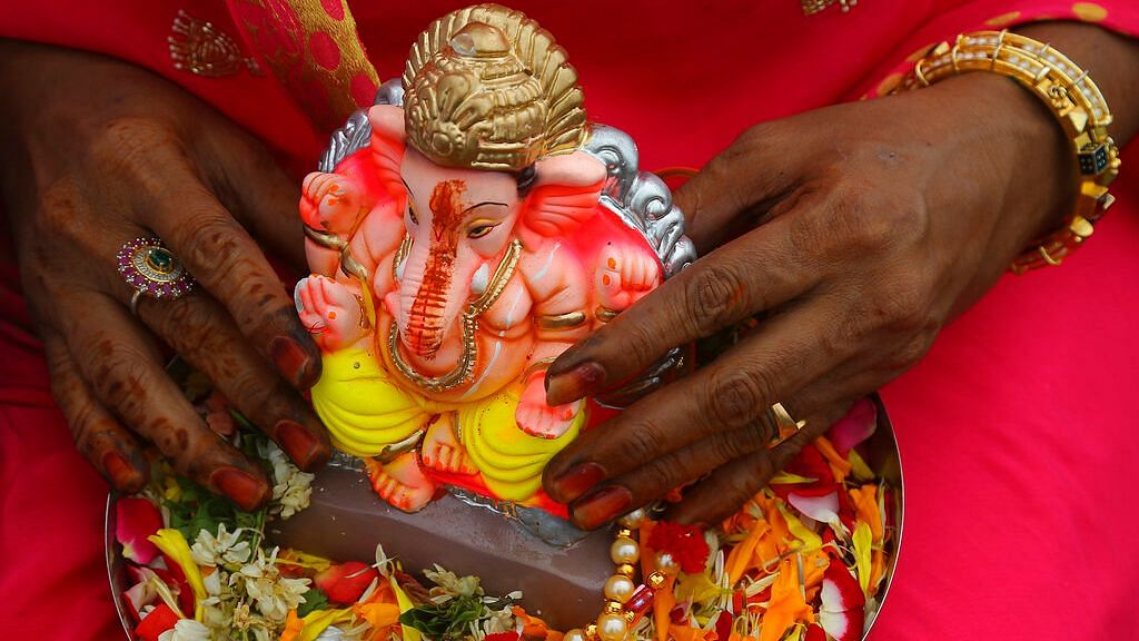 A woman carries an idol of Hindu god Ganesha to immerse it in Hussain Sagar Lake on the final day of Ganesha Chaturthi festival in Hyderabad, on  Thursday, 12 September 2019. Image used for representational purpose.