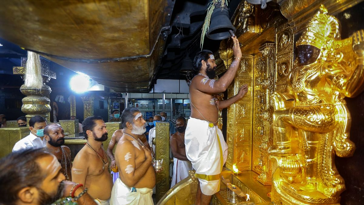 A file photo of the priests performing rituals for the opening of the Sabarimala temple on the first day of the holy Malayalam month of Chingam, in Pathanamthitta district, in August 2020.