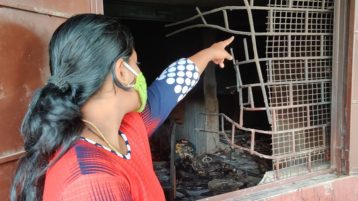 Ranjitha showing the wall, her house shares with the vandalised  bar.