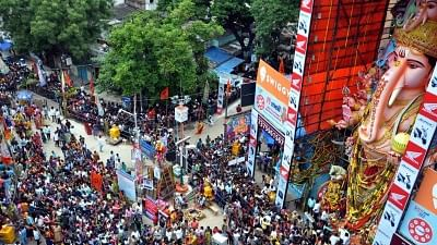 File Image: People offer prayers to Lord Ganesh to a 61-feet high idol of lord Ganesh at at Khairatabad on Ganesh Chaturthi in Hyderabad.