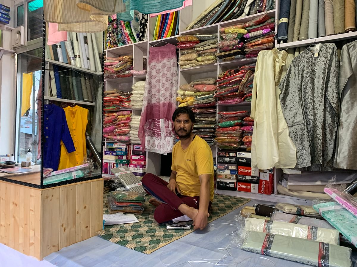 Plasma Donor Jehangir Hussain at his cloth shop in Budgam.