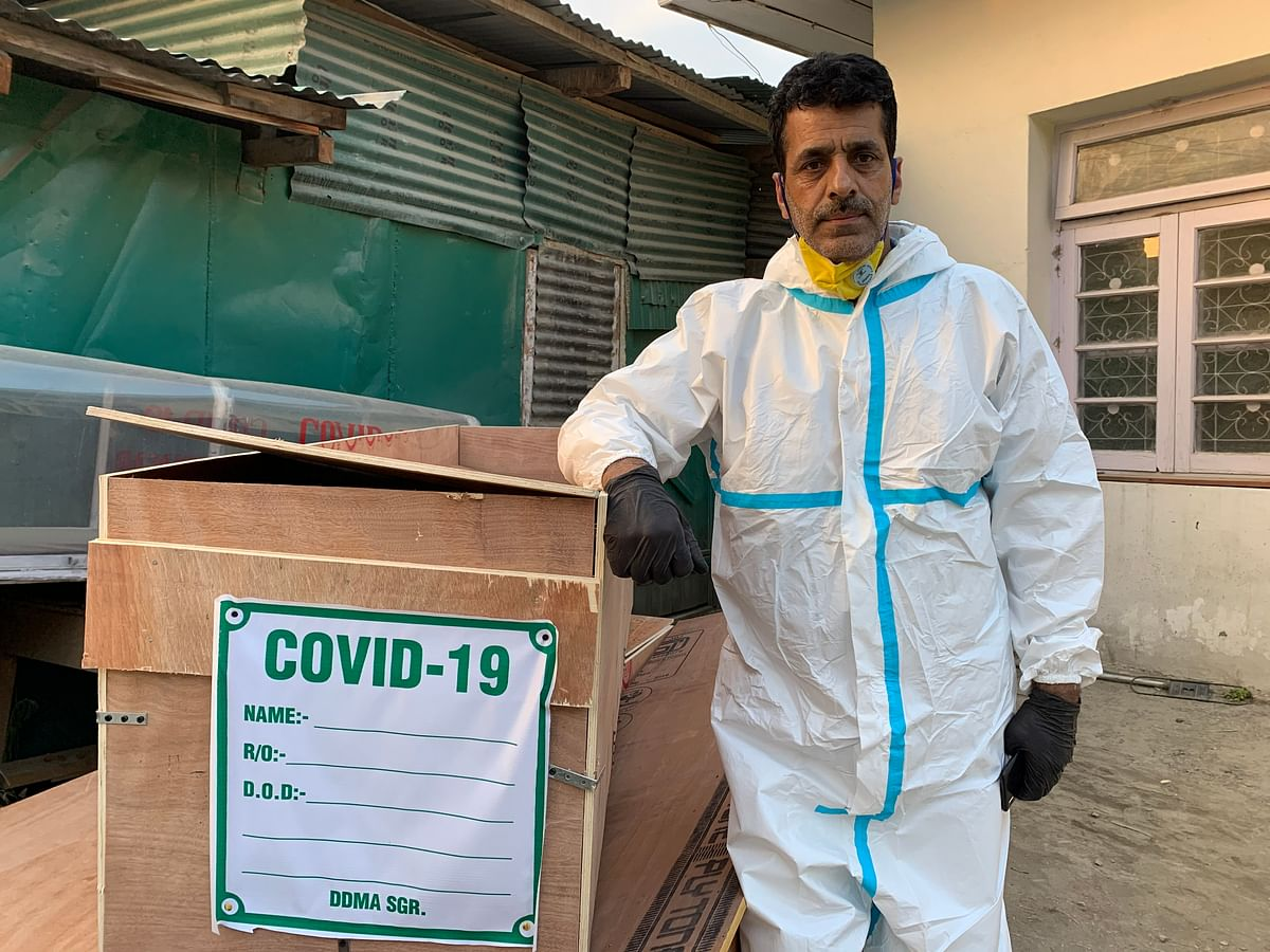 Driver Jameel Ahmed waiting on Tuesday, 28 July, for the body of a COVID-19 casualty outside the mortuary of SMHS hospital in Srinagar.
