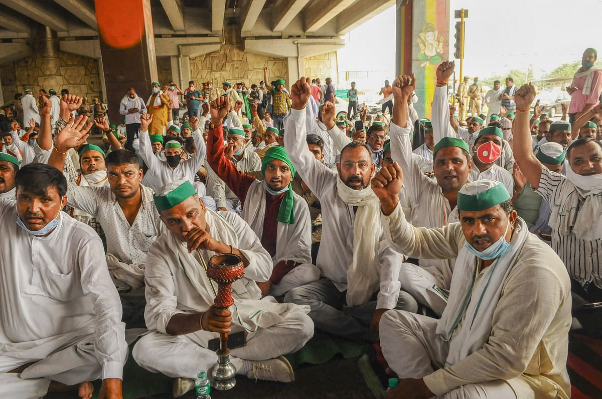 Bharatiya Kisan Union (BKU) leaders and farmers stage a protest against the central government policies on the first day of the Parliament session, at Delhi-UP border, Monday, 14 September, 2020.