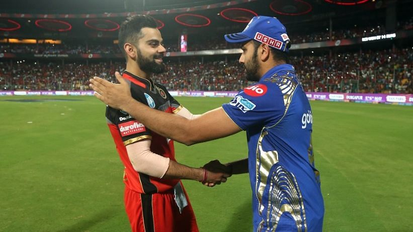 File photo: Virat Kohli  and Rohit Sharma shake hands after the match between the Royal Challengers Bangalore and the Mumbai Indians at the M Chinnaswamy Stadium in Bengaluru.