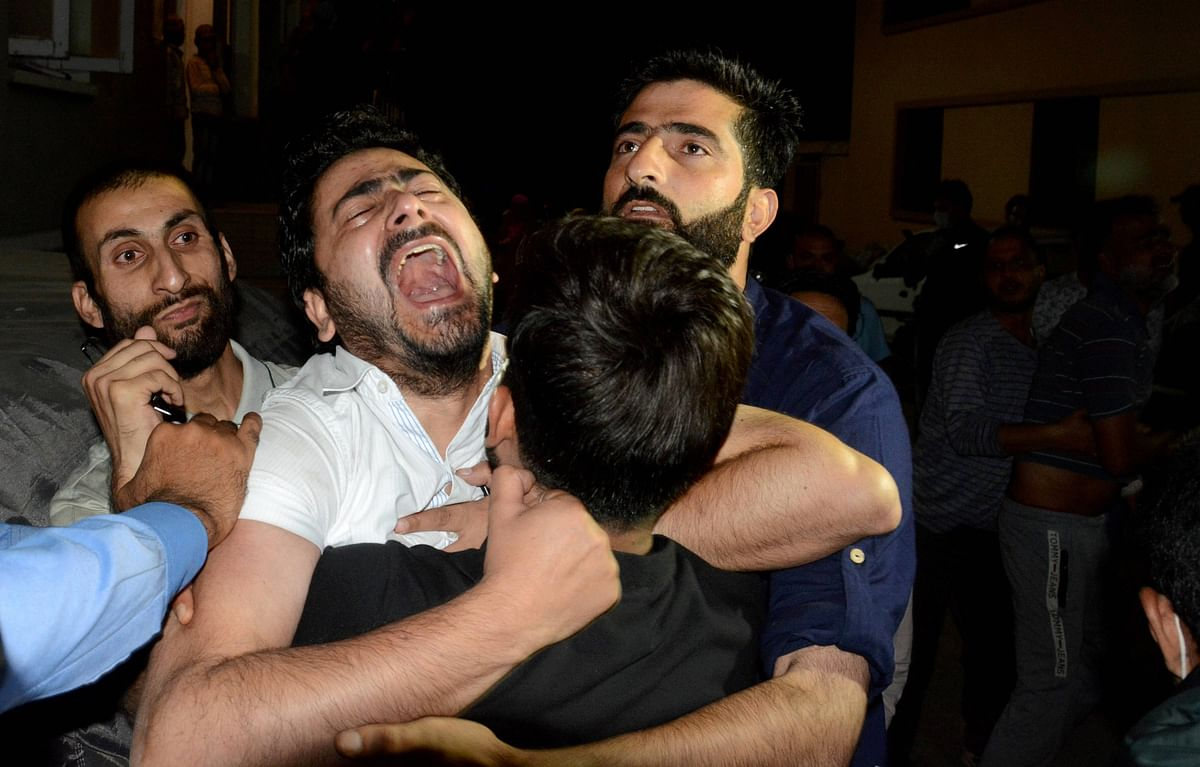 Brother of prominent Srinagar-based lawyer Babar Qadri, who was killed by unidentified gunmen, reacts during the funeral ceremony, at Hawal in Srinagar, Thursday evening, 24 September 2020.