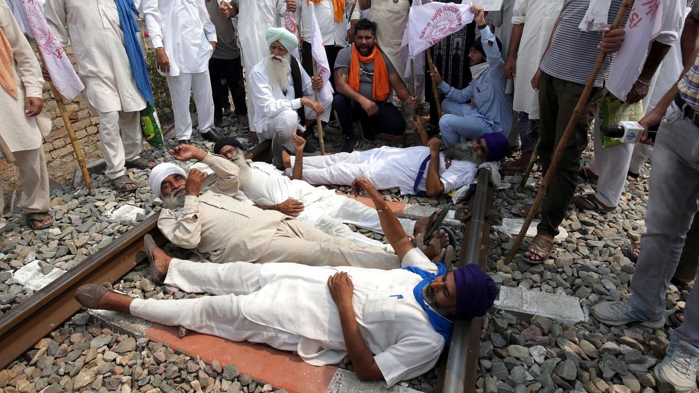 Nationwide Farmers' Protest LIVE News Updates. Farmers block railway tracks and shout slogans during the 'Rail Roko' agitation against the recently passed farm bills in Amritsar on 24 September.