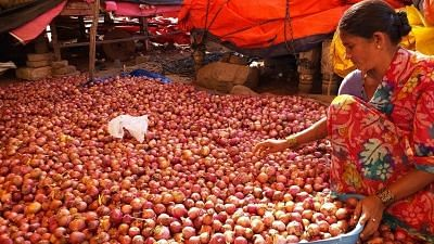 Hyderabad: Onion sellers at a wholesale market in Hyderabad on Dec. 7, 2019.