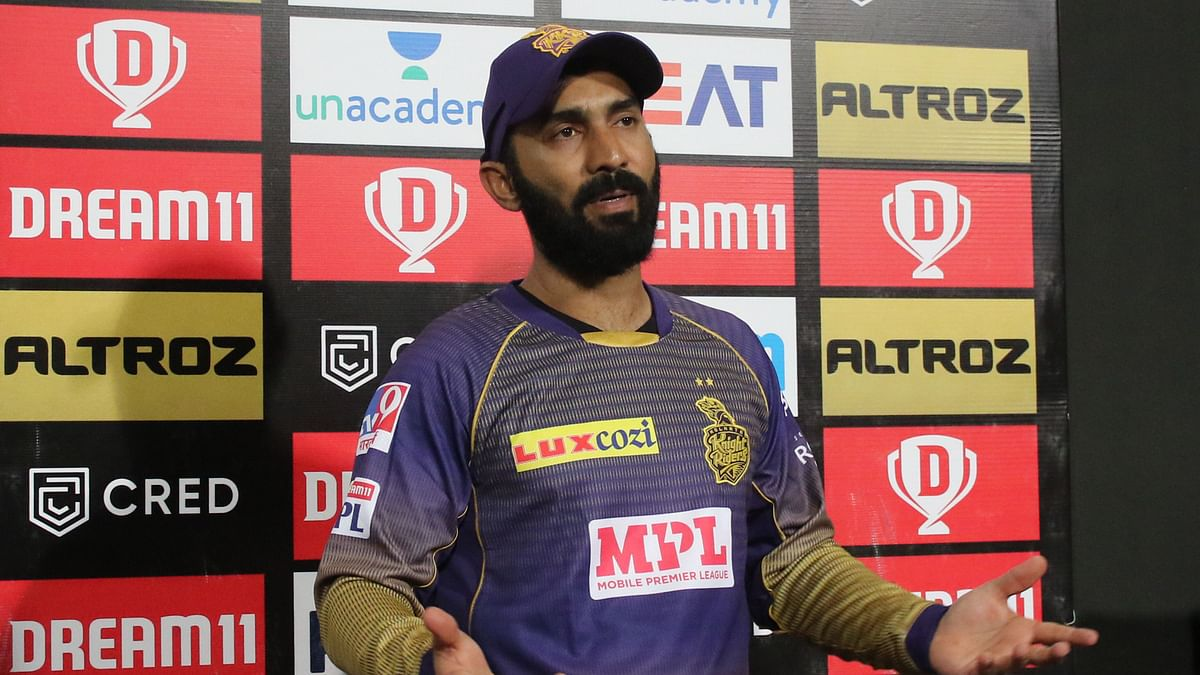 Dinesh Karthik defends Pat Cummins after the bowler leaks runs in the team's first match of IPL 2020.