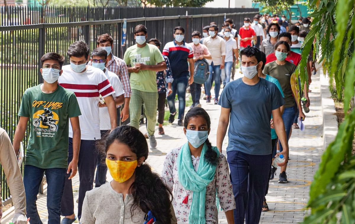 Students leave an examination centre after appearing for the JEE 2020 entrance papers, amid the ongoing coronavirus pandemic, in Gurugram.