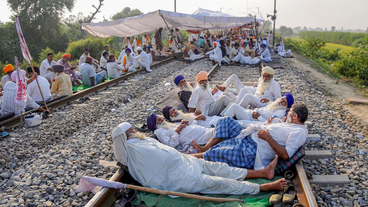 Farmers block a railway track during their protest against the new farm bills, at Devi Dass Pura village, about 20 kilometers from Amritsar, Friday, 25 September.