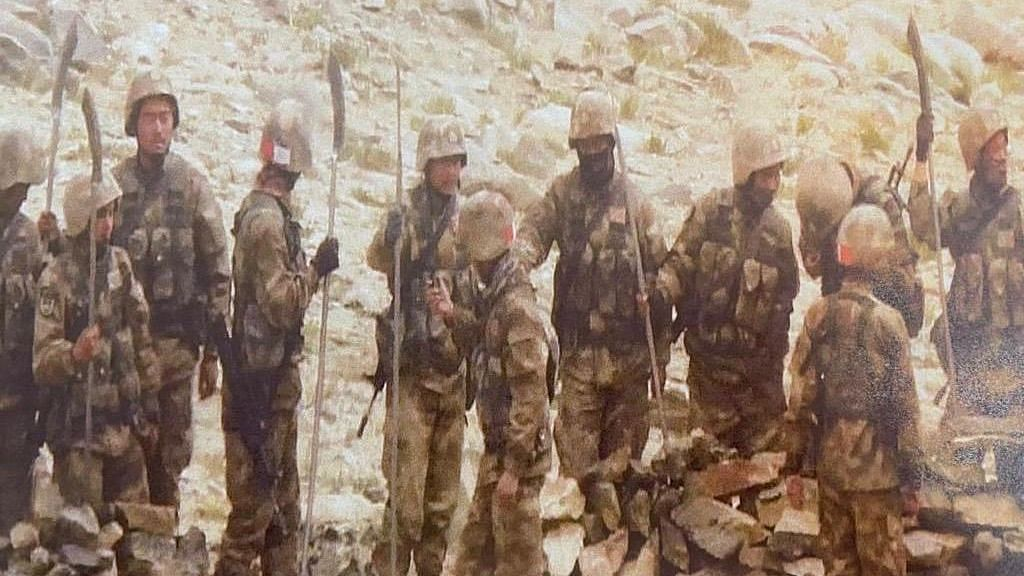 Chinese soldiers seen carrying spears & other sharp edged weapons near Mukhpari hill north of Rezang La after Monday firing incident.