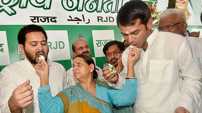 Tejashwi Yadav and Tej Pratap with mother Rabri Devi