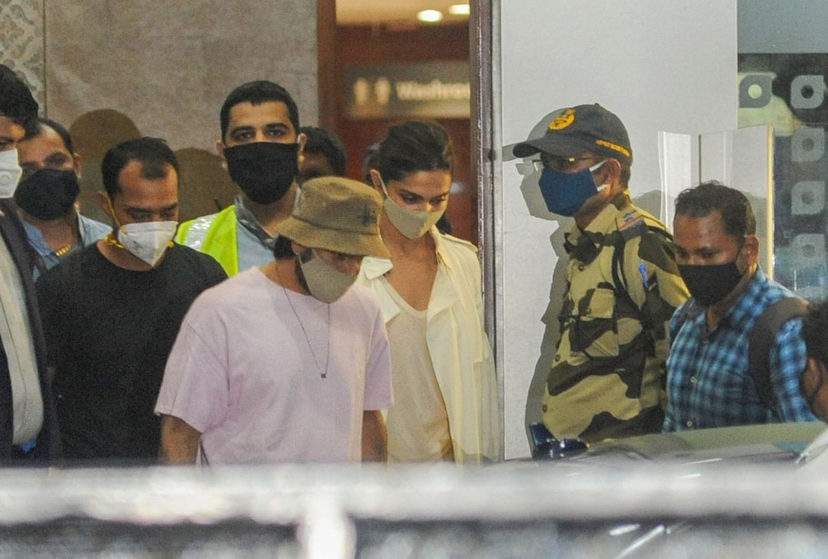 Bollywood actors Deepika Padukone and Ranveer Singh arrive at Mumbai International Airport, after the former was summoned by NCB in a Bollywood drugs probe, in Mumbai, Thursday, 24 September, 2020.