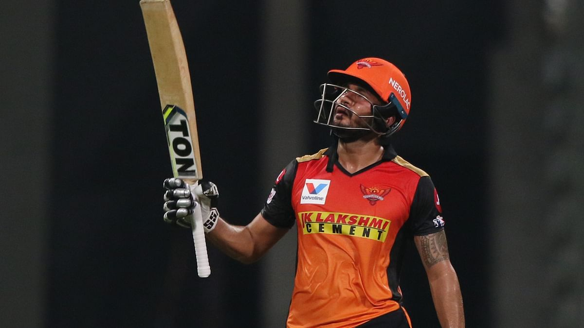 IPL 2020: Manish Pandey lifts his bat to celebrate a half century against KKR on Saturday night in  Abu Dhabi.