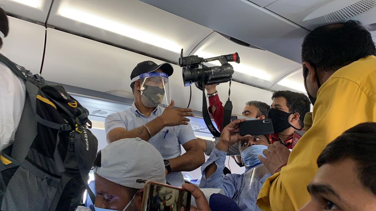 Media when told that filming is strictly prohibited on the flight.