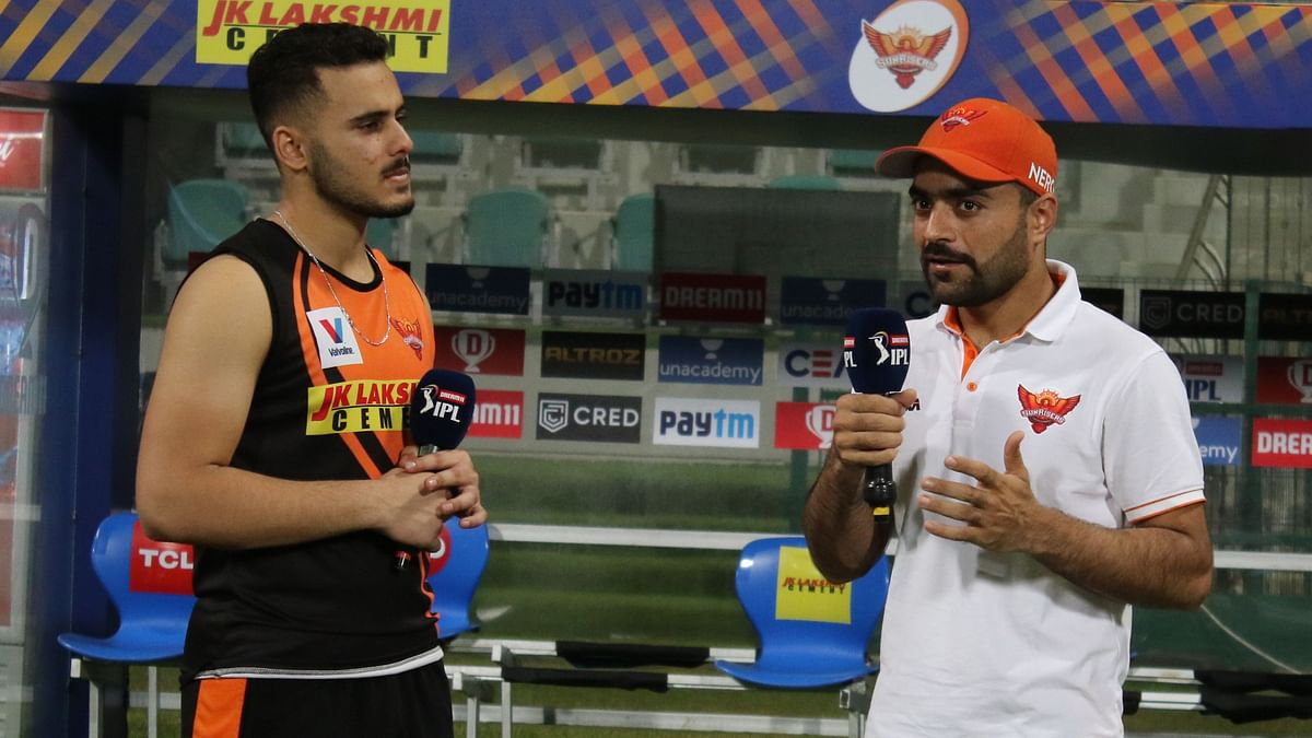 Rashid Khan in conversation with his teammate Abdul Samad after Sunrisers Hyderabad's win against Delhi Capitals.