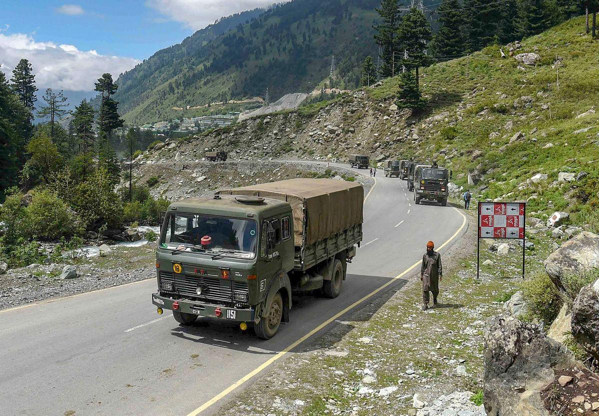 Army convoy moves on Srinagar- Ladakh highway at Gagangir, in Ganderbal district of Central Kashmir.