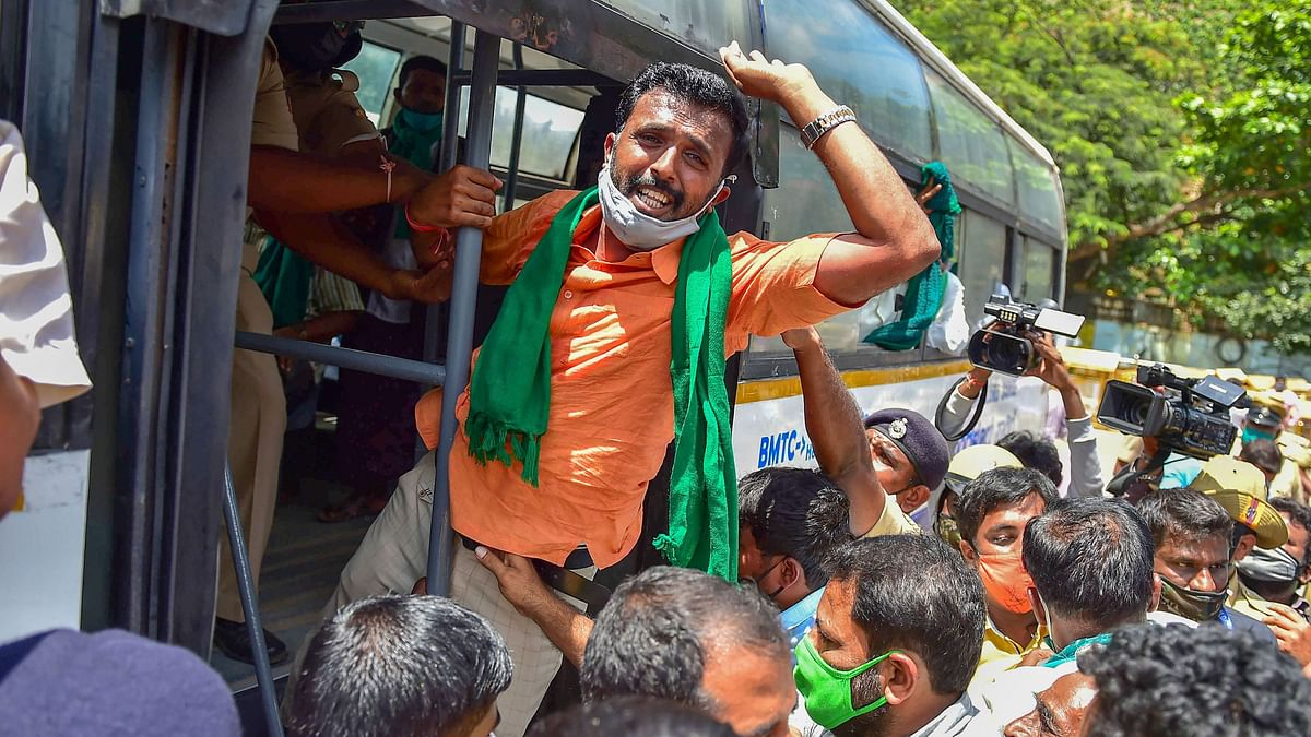 Members of various farmer organisations being detained by the police during Bharat Bandh, a protest against the farm bills passed in Parliament recently, in Bengaluru, Friday, 25 September.