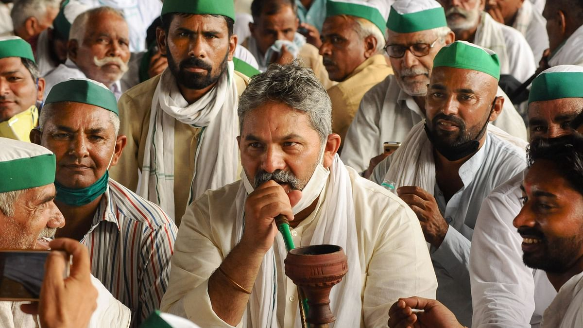 Bharatiya Kisan Union (BKU) leaders and farmers stage a protest against the central government policies on the first day of the Parliament session, at Delhi-UP border, Monday, 14 September 2020.