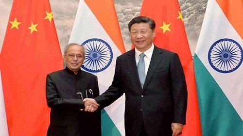 Former President of India Pranab Mukherjee and Chinese President Xi Jinping.