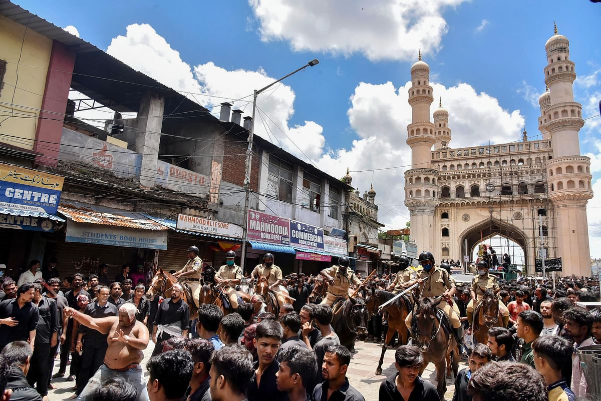 Shia Muslims take part in a procession during Muharram, at Charminar in Hyderabad, on 30  August 2020.