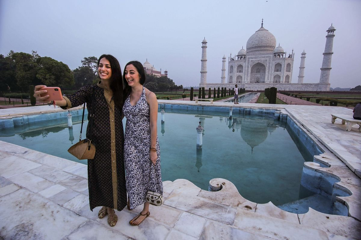 Tourists take selfies at the historic Taj Mahal, after the monument reopened for public during 'Unlock 4'.
