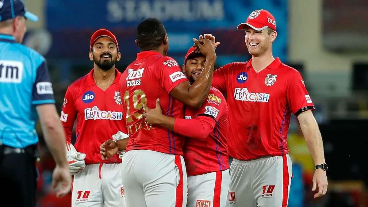 Captain KL Rahul starred with the first century of the season as Kings XI Punjab cruised to a massive <br>97-run win over Royal Challengers Bangalore