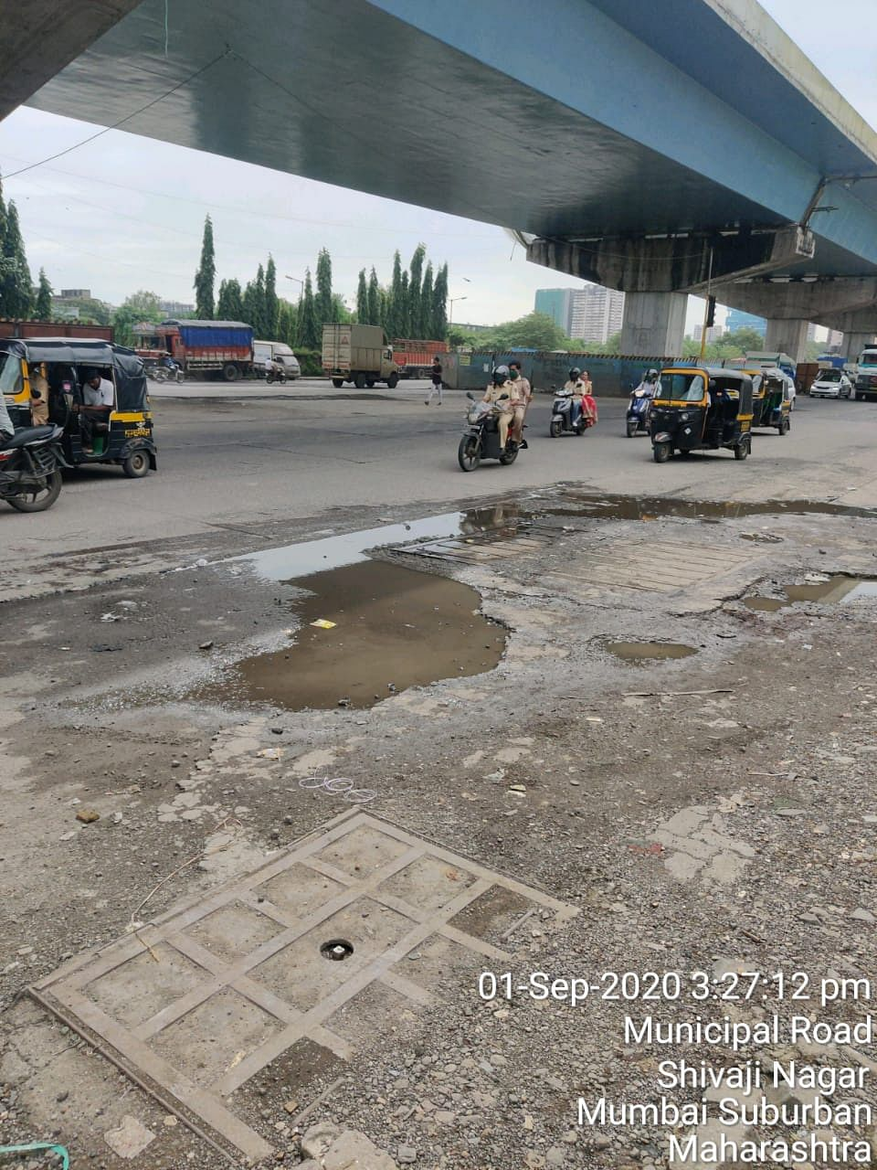 One of the huge potholes at Baiganwadi juntion.