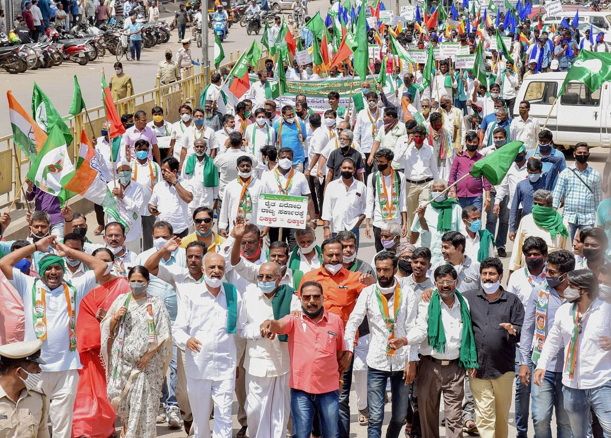 Members of various organisations along with farmers stage a protest against the passing of agriculture reform bills in the Parliament, in Shimoga, Monday, 28 September, 2020.