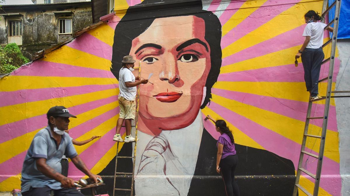 Artists paint a mural of late Bollywood actor Rishi Kapoor ahead of his birthday, at Bandra in Mumbai