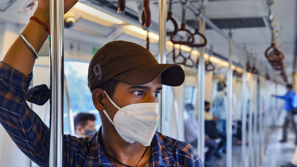 Commuters travel in a train after Delhi Metro resumed services with curtailed operation of the Yellow Line and Rapid Metro, amid the ongoing coronavirus pandemic, in New Delhi.
