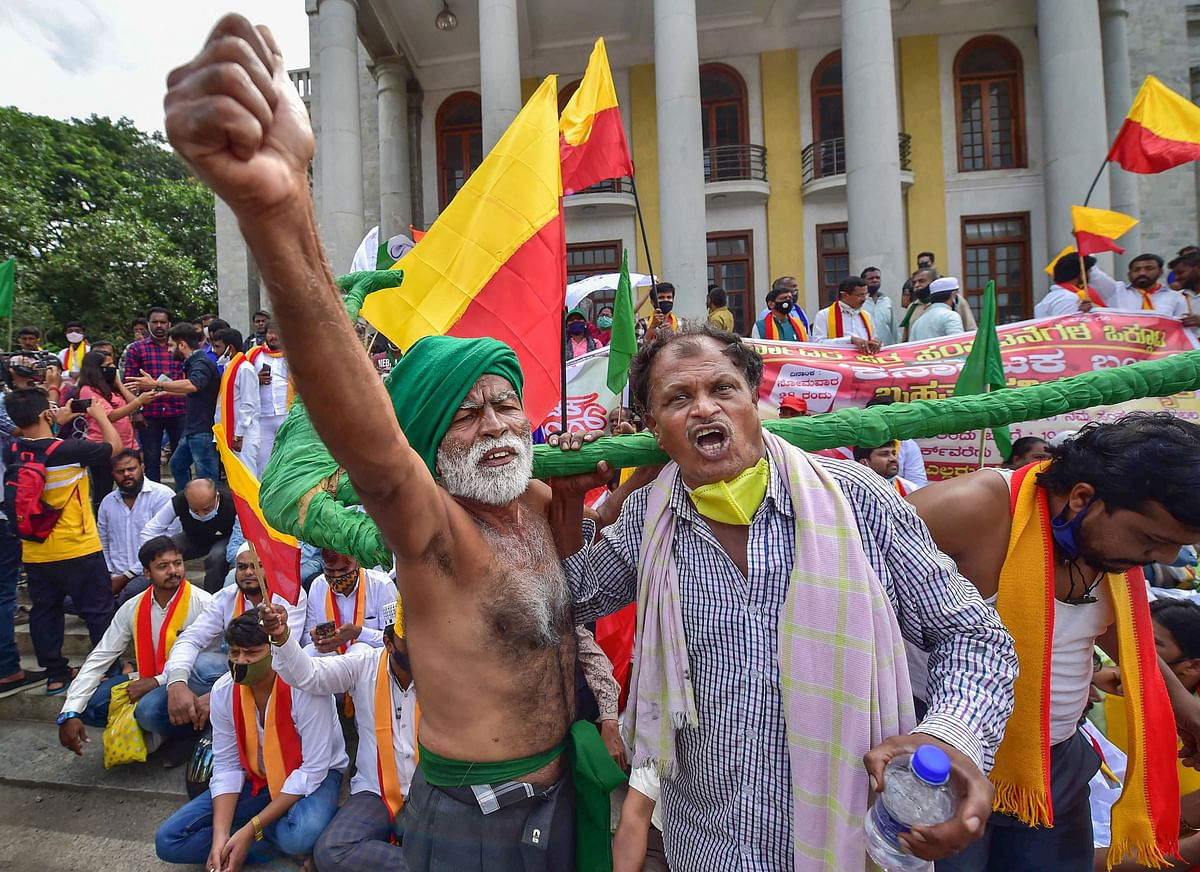 Members of various organisations along with farmers raise slogans during a protest against the farm reform bills passed in Parliament recently, in Bengaluru, Monday, 28 September, 2020.