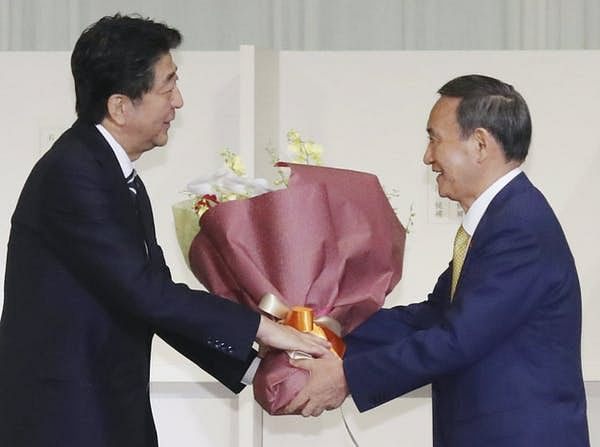 Yoshihide Suga takes over from Japan's longest-serving prime minister, Shinzo Abe