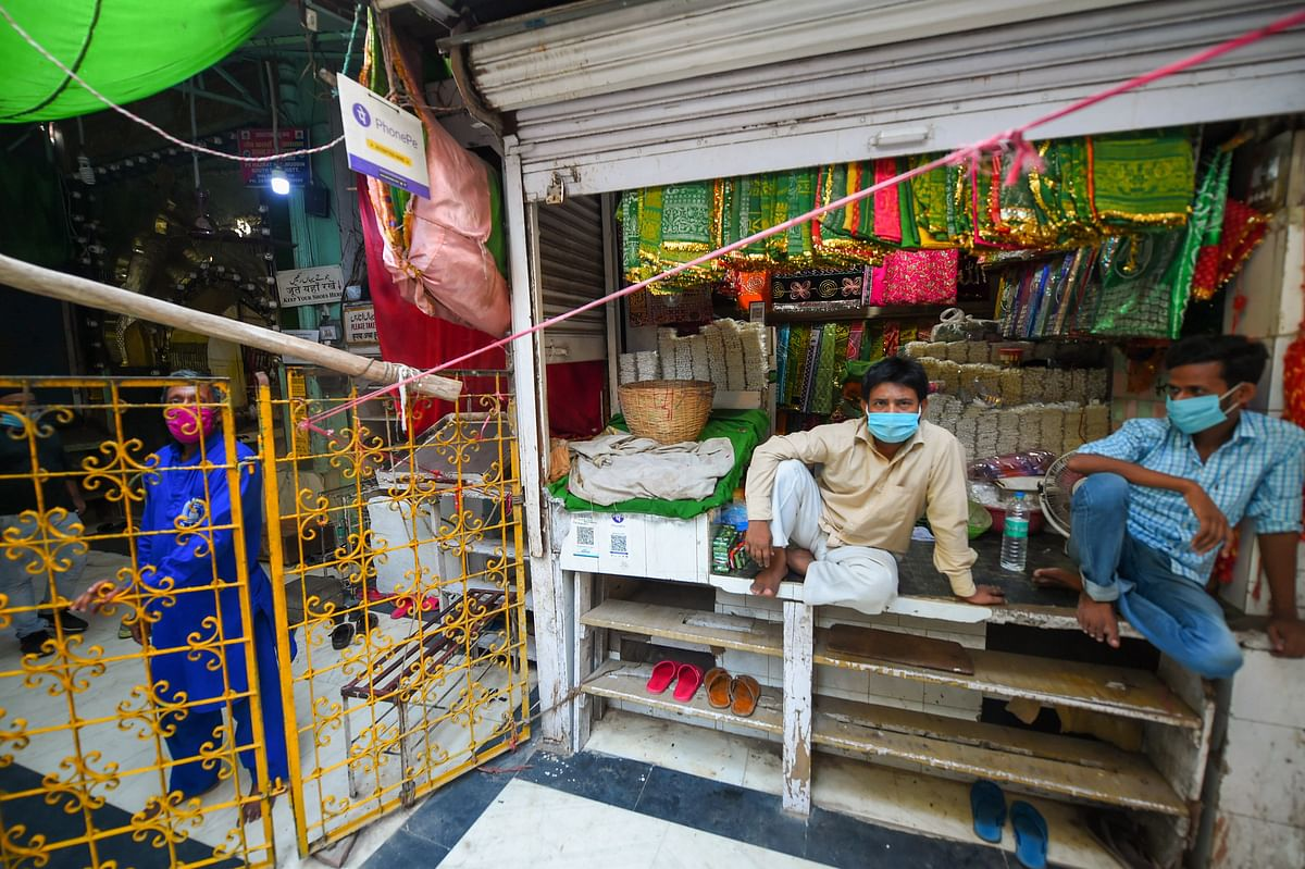 A shopkeeper waits for customers at his shop near Hazrat Nizamuddin shrine, during unlock 4.0, in New Delhi, Saturday, 5 September, 2020. The mausoleum of Muslim saint Hazrat Nizamuddin will reopen for devotees on Sunday, 6 September, with strict social distancing norms in place six months after it was closed as part of sweeping measures of check the COVID-19 pandemic.