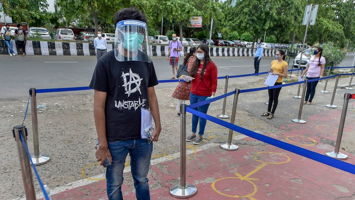 Students wait in queue, maintain social distancing outside exam centers. Image used for representation.