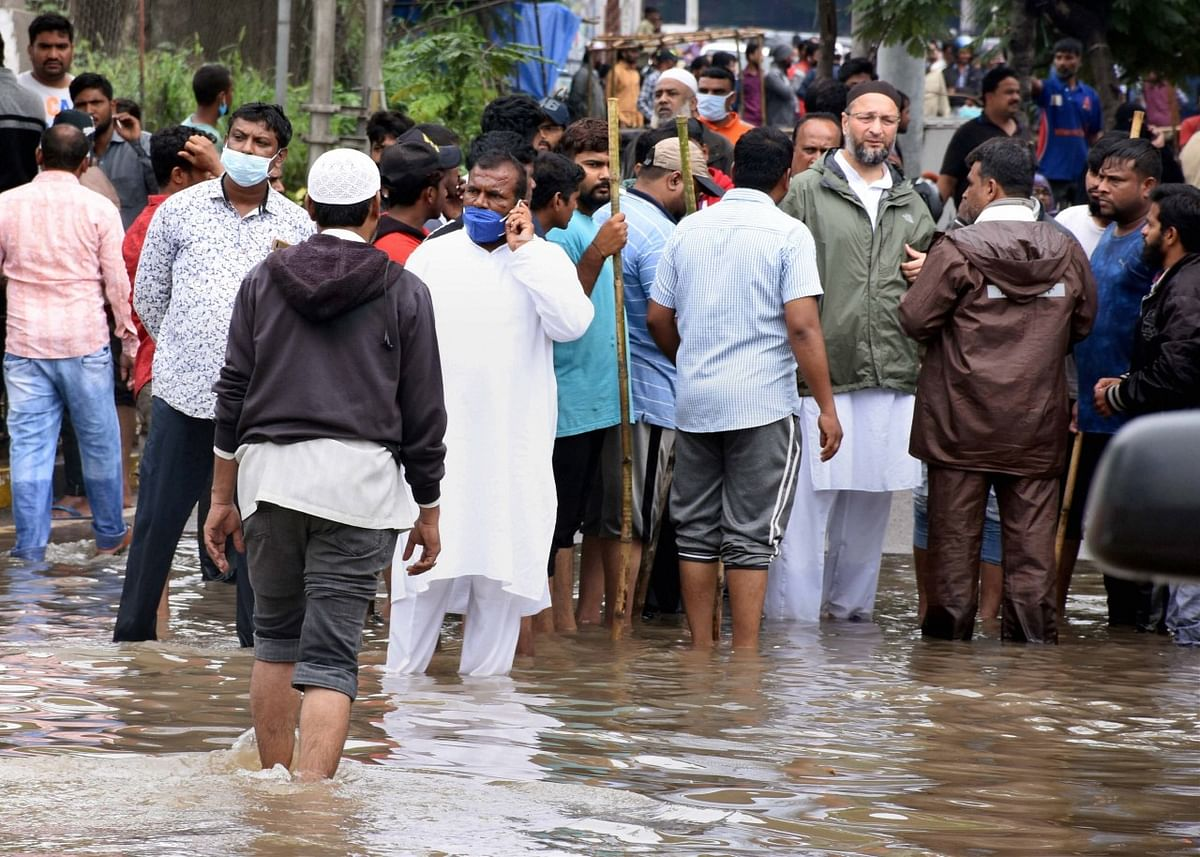 All India Majlis-e-Ittehadul Muslimeen President Asaduddin Owaisi supervises the rescue work following heavy rains, at Falaknuma Chandrangutta in the old city of Hyderabad, Wednesday, Oct. 14, 2020.